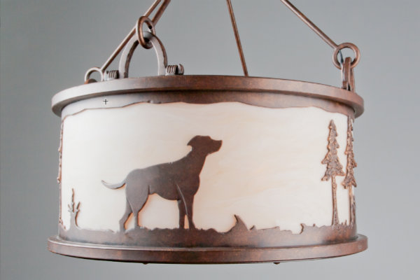 A client gave us a few photographs of her dog to incorporate in one of her light fixtures, shown here.