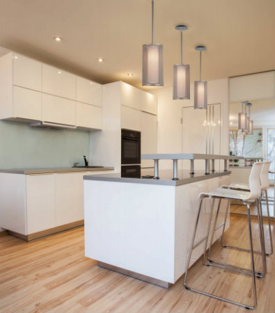 These urban chic Uptown Mesh pendants beautifully illuminate a bright, modern kitchen without weighing the space down.