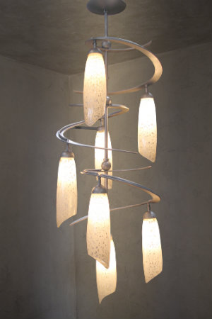 Our cascading Luna Chandelier -- a custom piece from the Lightspann collection -- features blown glass shades and a swirling framework with a gorgeous metallic beige silver finish.