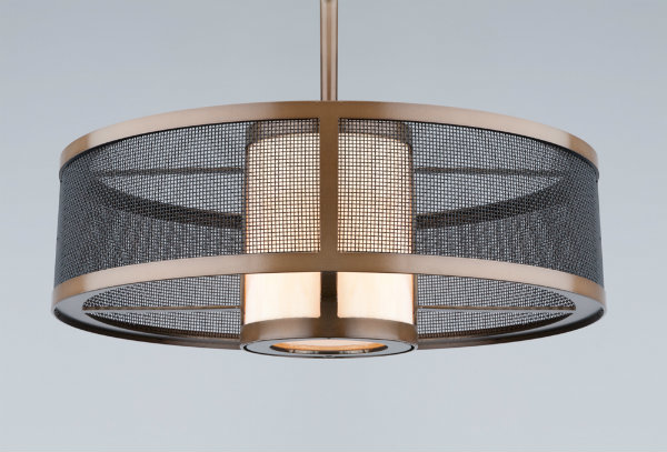 A warmer palette of light glass and a copper finish lean this mesh drum light towards a transitional Craftsman style.