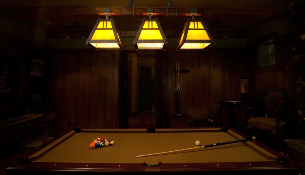 A modified catalog Craftsman pool light (PL8092) is the focal point in this game room with an arts and crafts architectural styling..