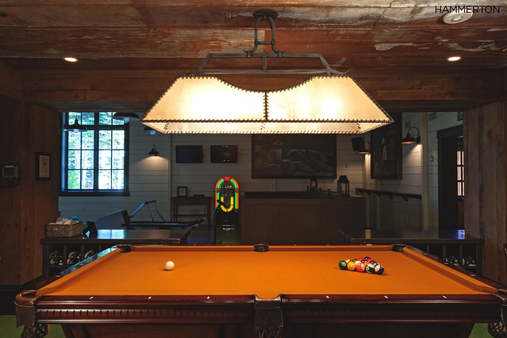 Rawhide and leather lashing complement this rustic farmhouse style game room.