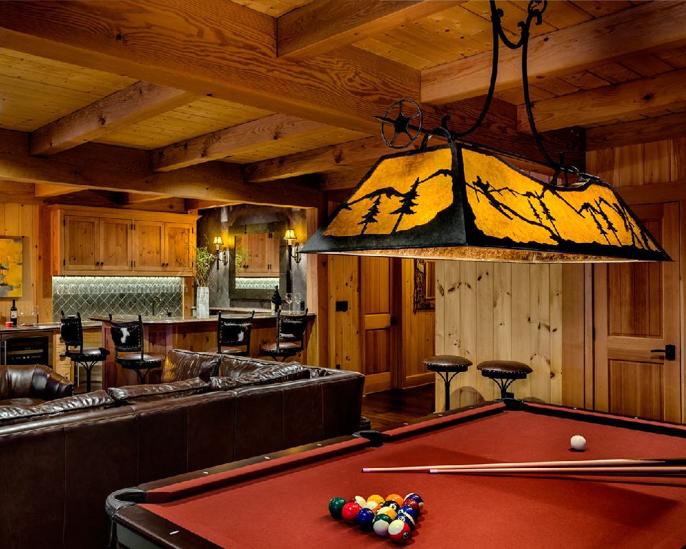 The owner of this home requested a fixture depicting her love of snow skiing, while the fixture itself exudes a warm glow that works well with the warm wooden tones of the room.