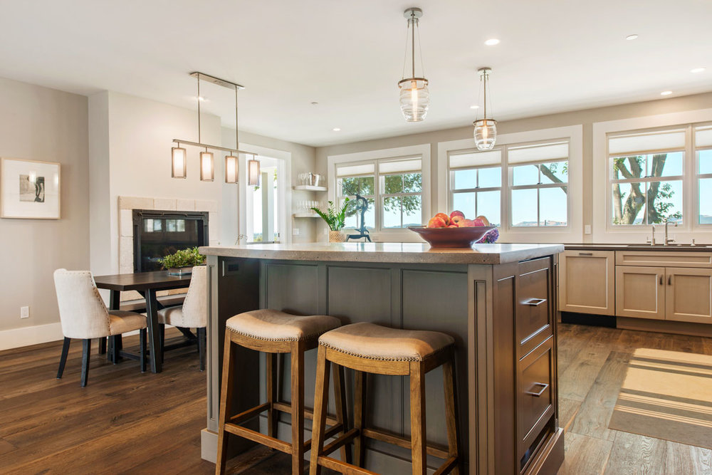 Above and below: A remodeled Napa, CA farmhouse with Ovo blown glass pendants above the kitchen and Uptown Mesh fixtures in the dining area and entry.