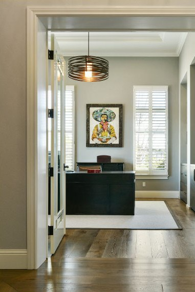 A Tempest drum draws the eye upward in this clean-lined office.