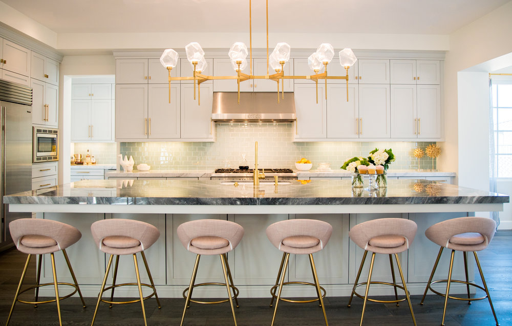 This glamorous modern kitchen features a Gem Belvedere linear suspension in Gilded Brass finish. Designer Jaki Yermian is making a name for herself and her Carlsbad, CA based firm  JY Design Interiors  with her ethereal designs.