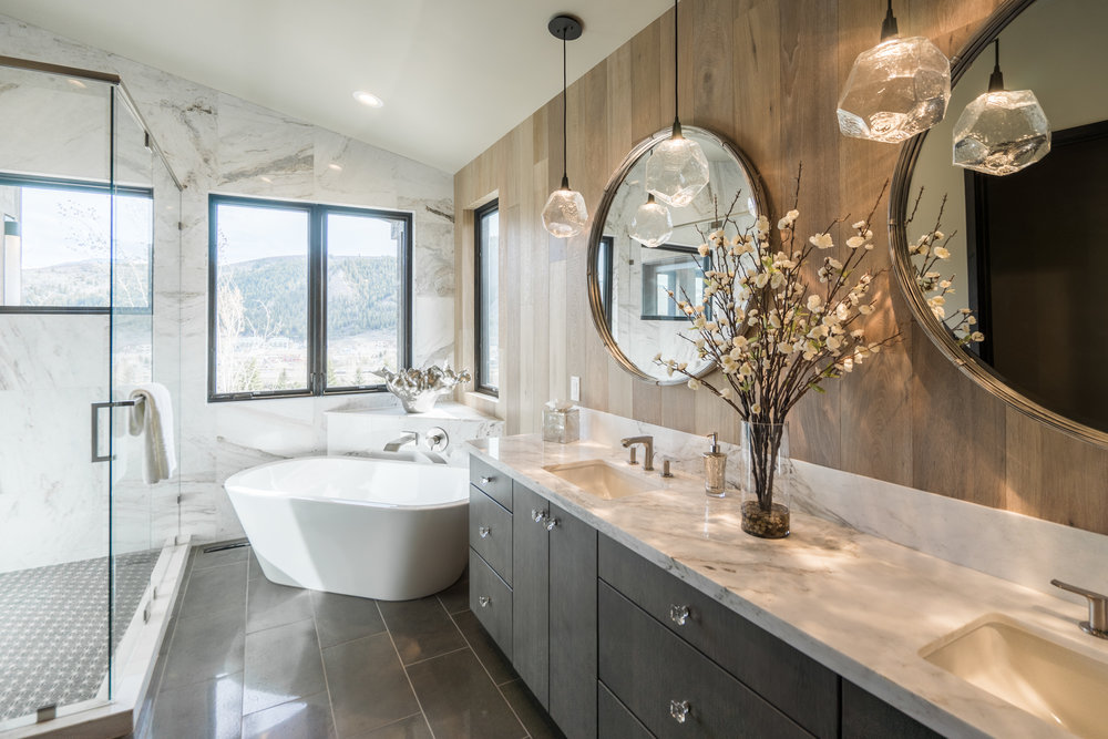 Gem pendants sparkle above the vanity in this master bath interior by  AP Resort Concepts .  S ee more of Vail, CO designer Annette Phan's work in our Eclectic Mountain Condo case study >
