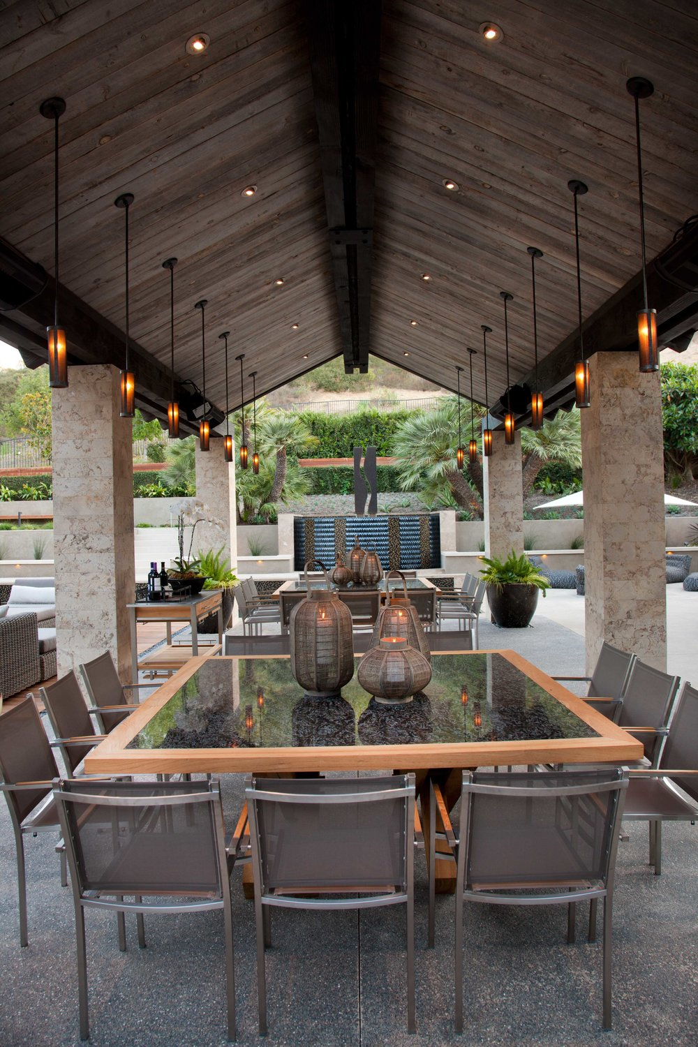 Two rows of custom Hammerton LA2102 pendants in an outdoor living space designed by Lori Gentile Interior Design | Solanan Beach, CA
