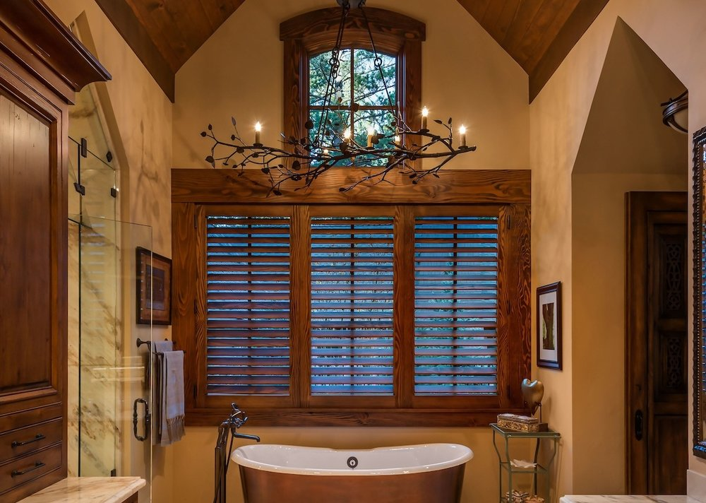 CH7175 shines above a copper clawfoot tub in this mountain rustic luxury bath | Lake Tahoe, CA