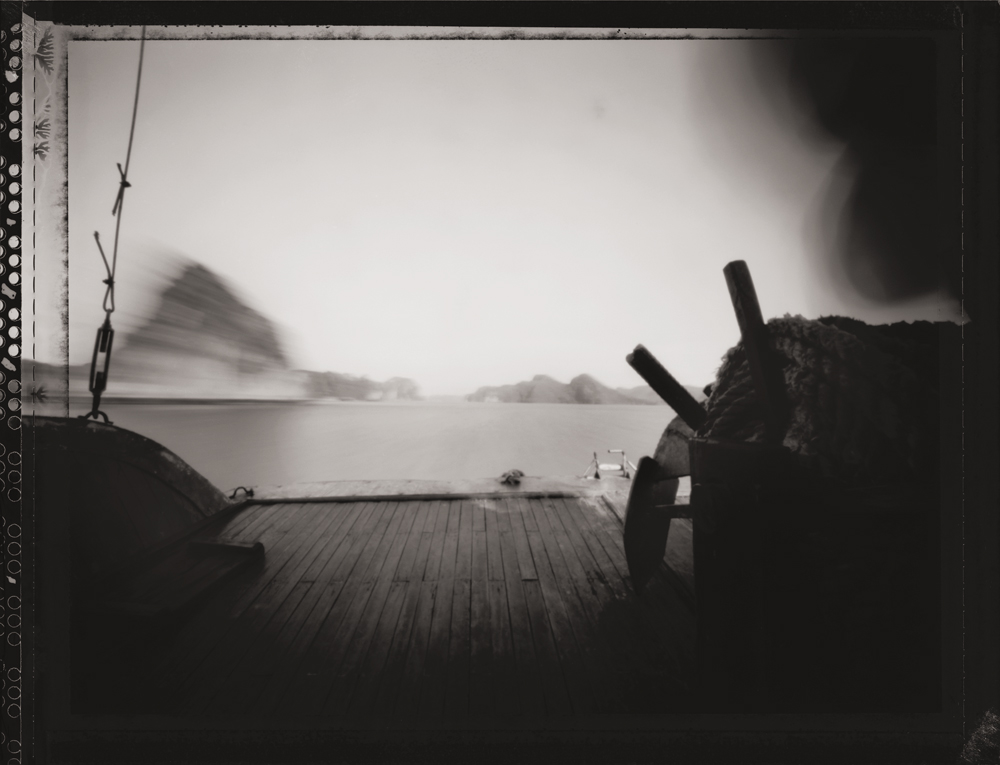 Man Looking into Camera, Traveling to Halong Bay ,  UNESCO World Heritage Site.  Pinhole Image © 2007.