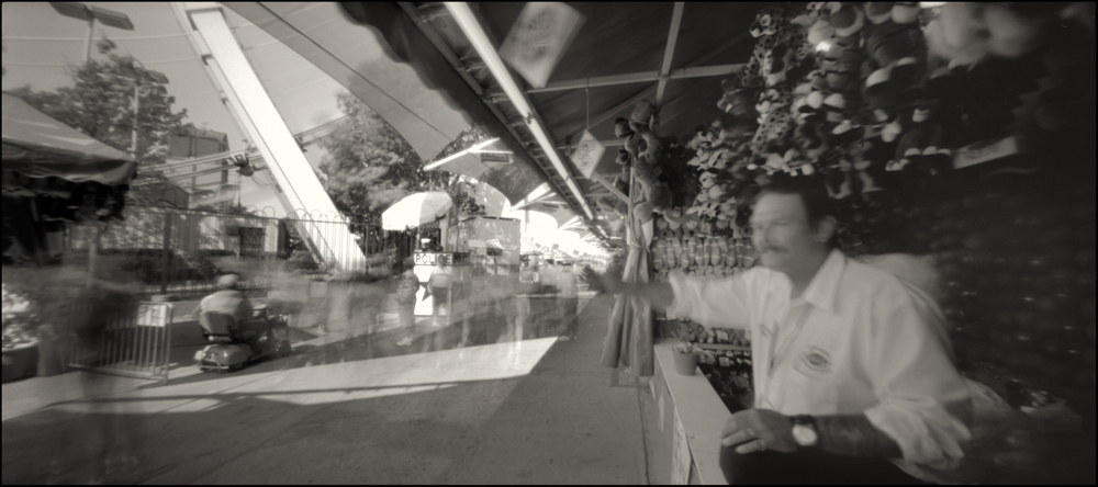 Dennis, Midway Darts.  Panoramic Pinhole Image © 2008.