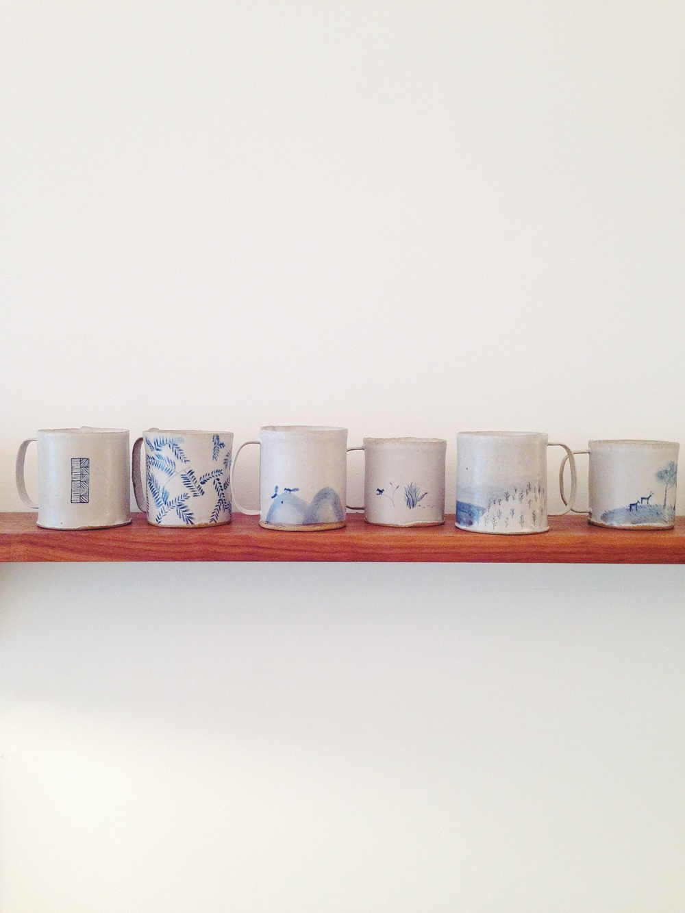 hand-painted BDDW ceramic mugs are now available at our store