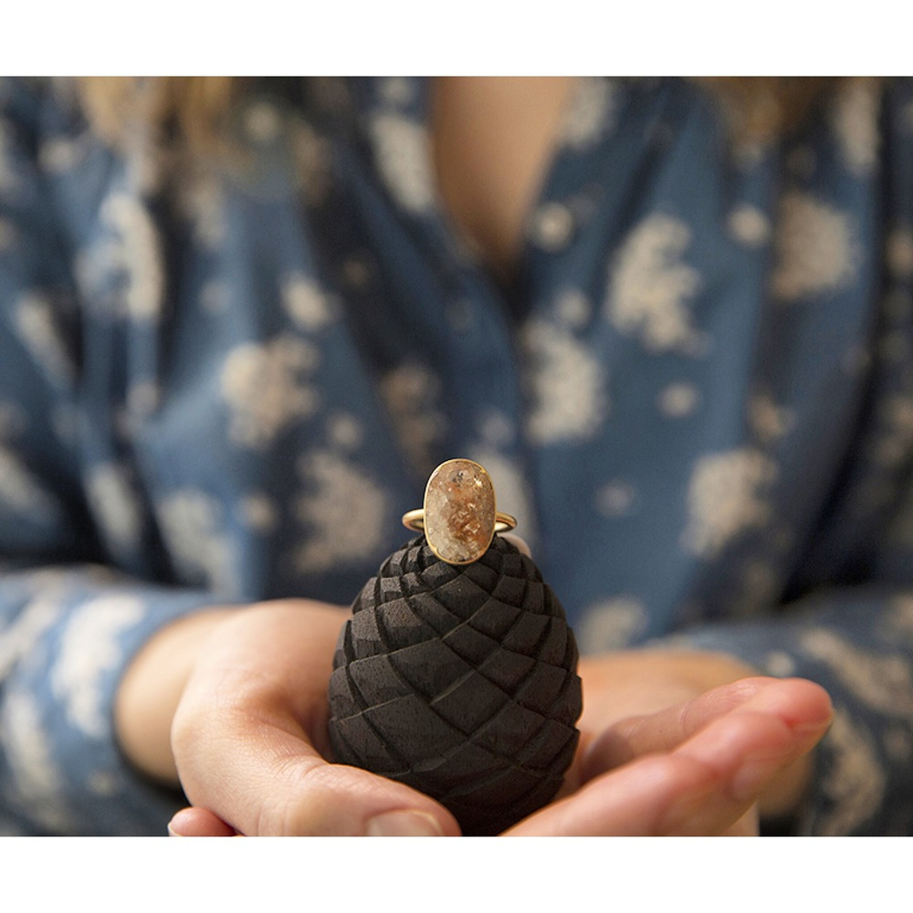 Our hand-carved pine cone ring box, each a one-of-a-kind, just like your fairy tale.
