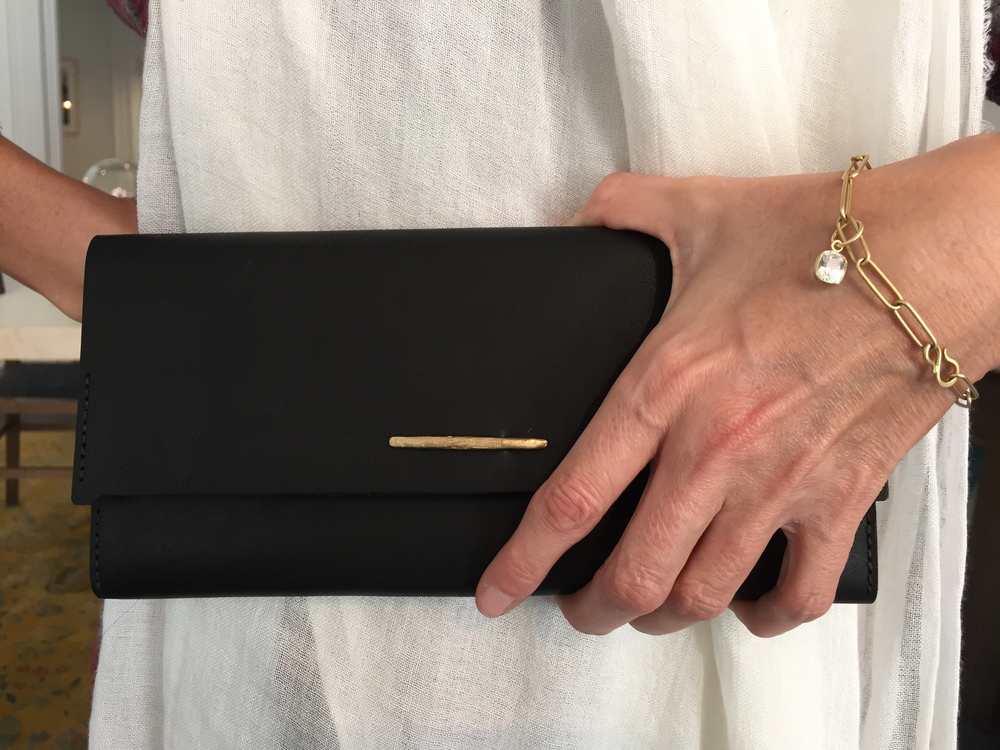 Our new maria beaulieu heavy weight signature bracelet with white sapphire and Melete Design Night Falls clutch make one chic pair