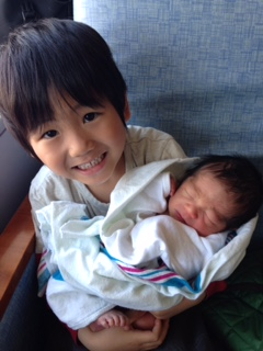 Kai and his newborn baby brother: Louis!