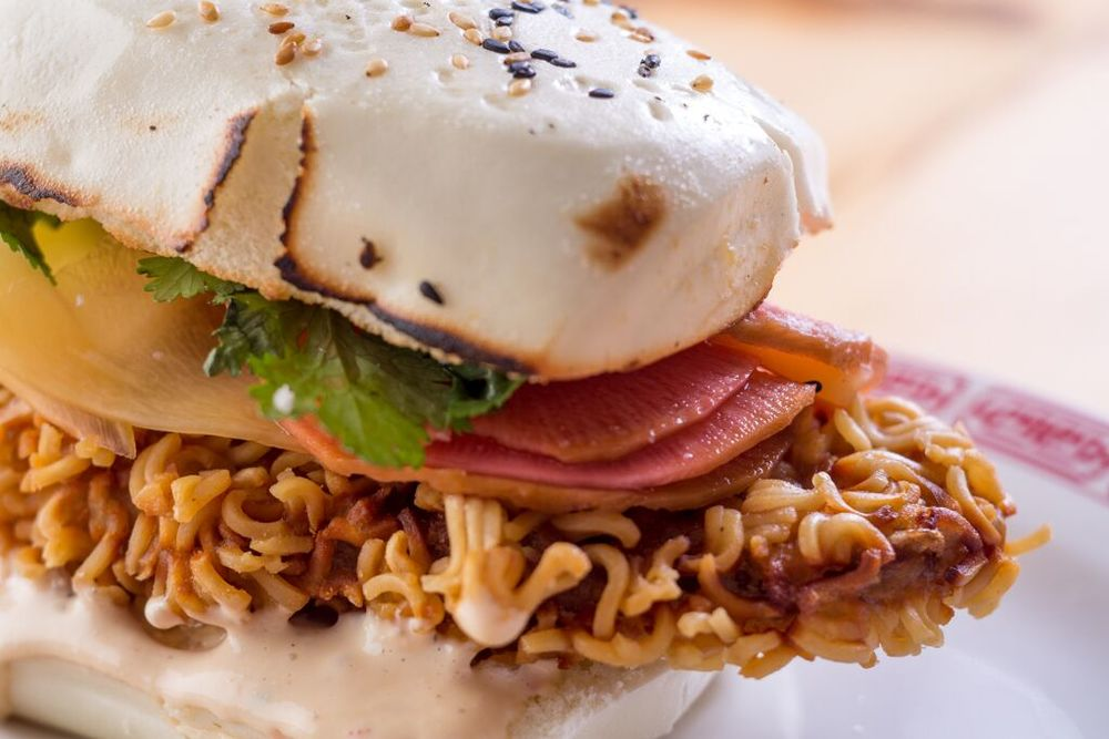Hong Kong Fried Chicken Sandwich with pickled green mango and daikon