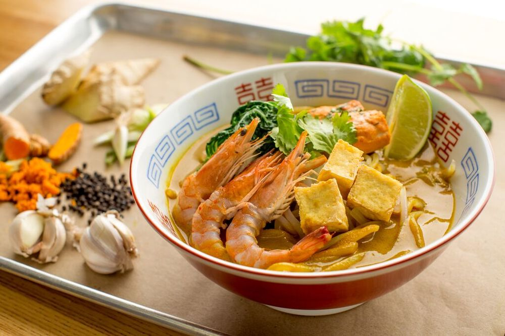 Seafood Laksa with Prawns, salmon mousse cake and bok choy shoot