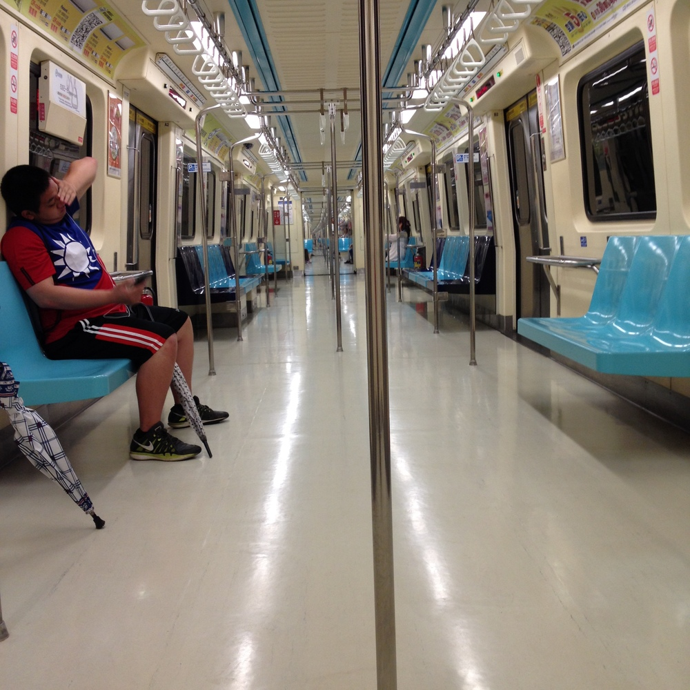 Riding the MRT. I was impressed by how wide and clean the car was. I was also amused by how far down the train you could see when it is empty.