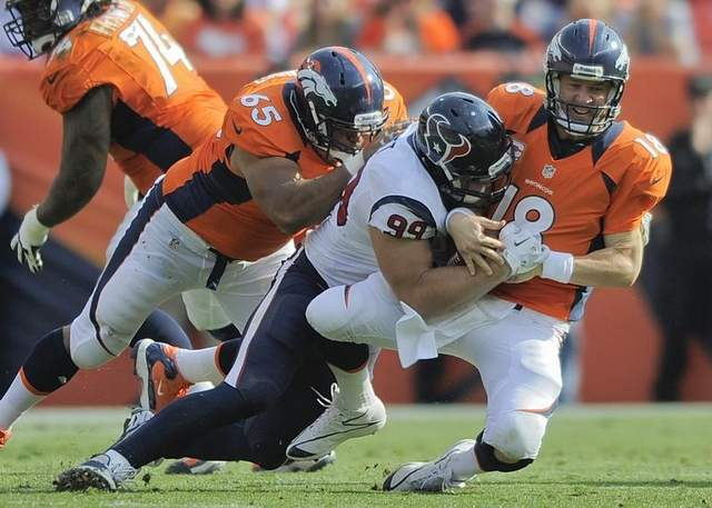 Falling Down: The precarious line situation in Denver bodes ill for Manning's health.
