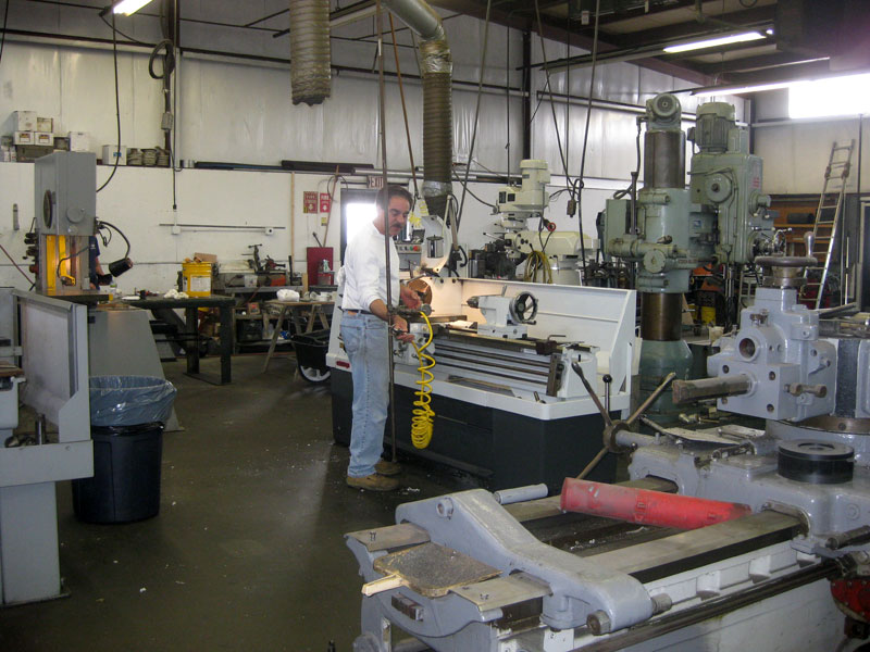Machine shop newport shipyard for Outboard motor machine shop