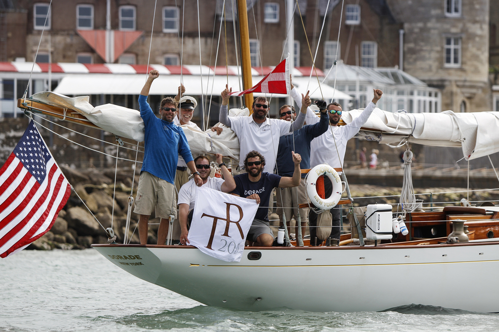 The crew on   Dorade   celebrate reaching the Royal Yacht Squadron to conclude their     Transatlantic Race 2015.