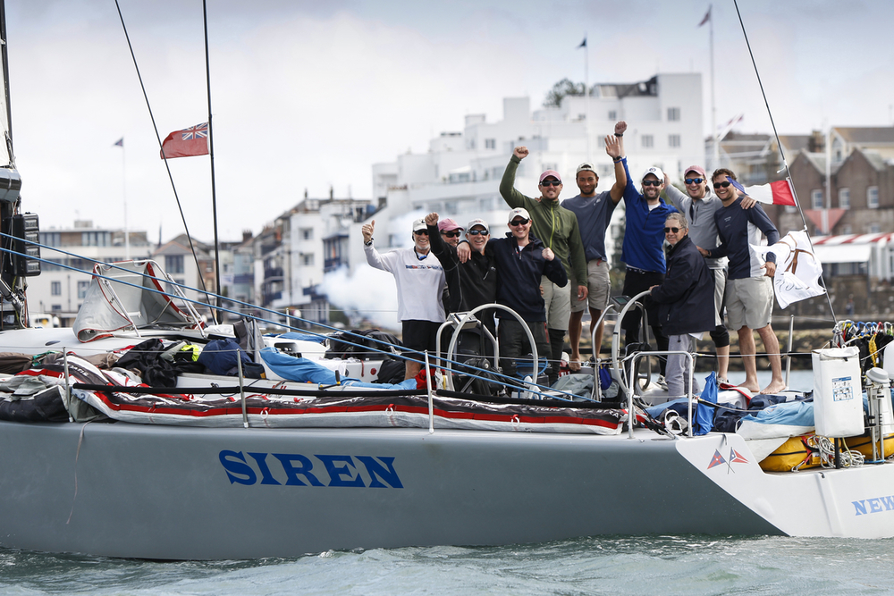 The crew of Siren are all smiles at the Transatlantic Race 2015 finish line. (photo credit ELWJ Photography)