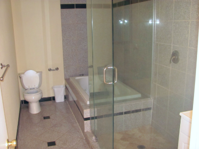 Bathrooms are spacy and include bathtub and standing showers.