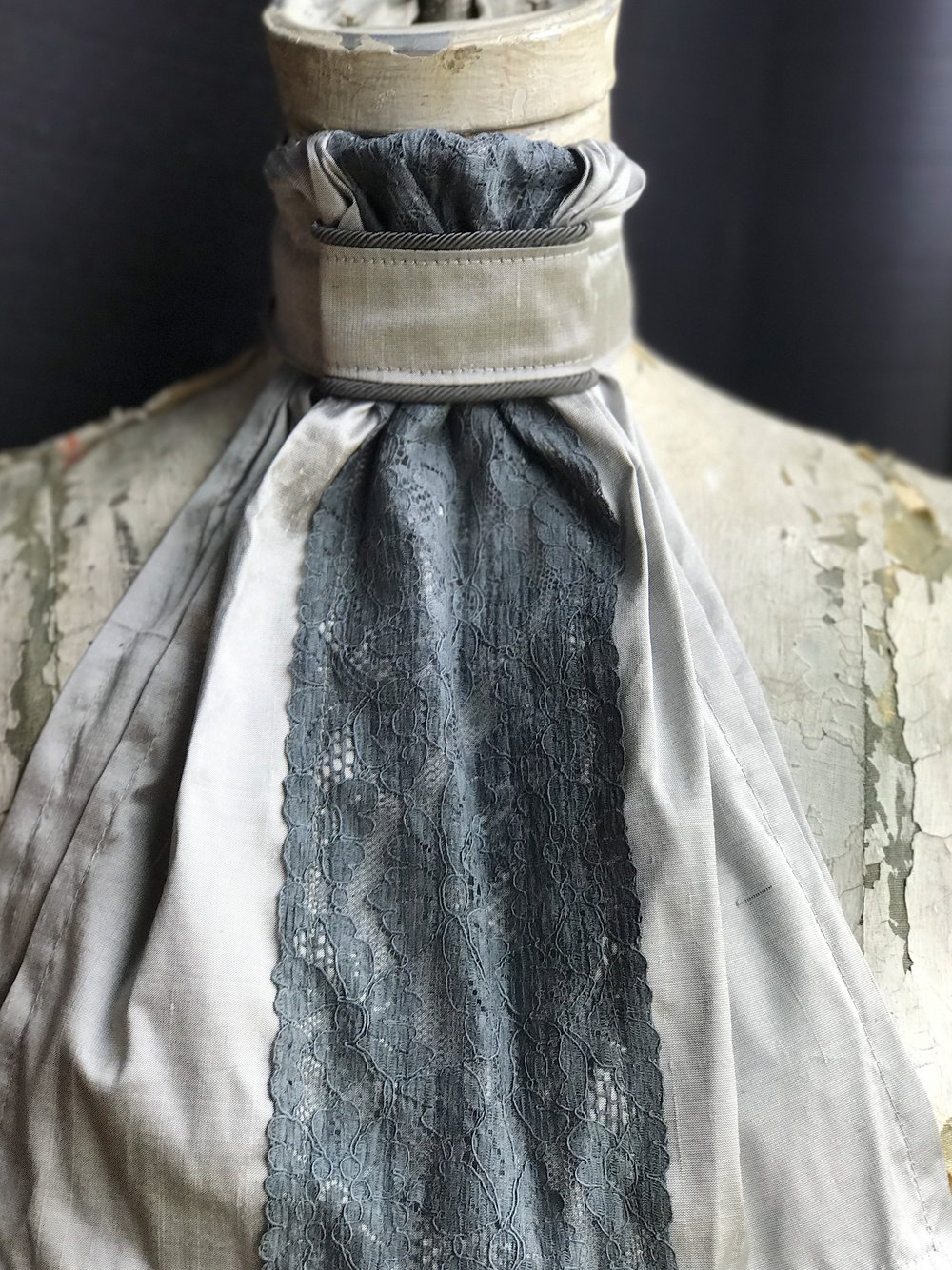Gray silk tie with gray Italian lace running vertically for an elegant look and feel.