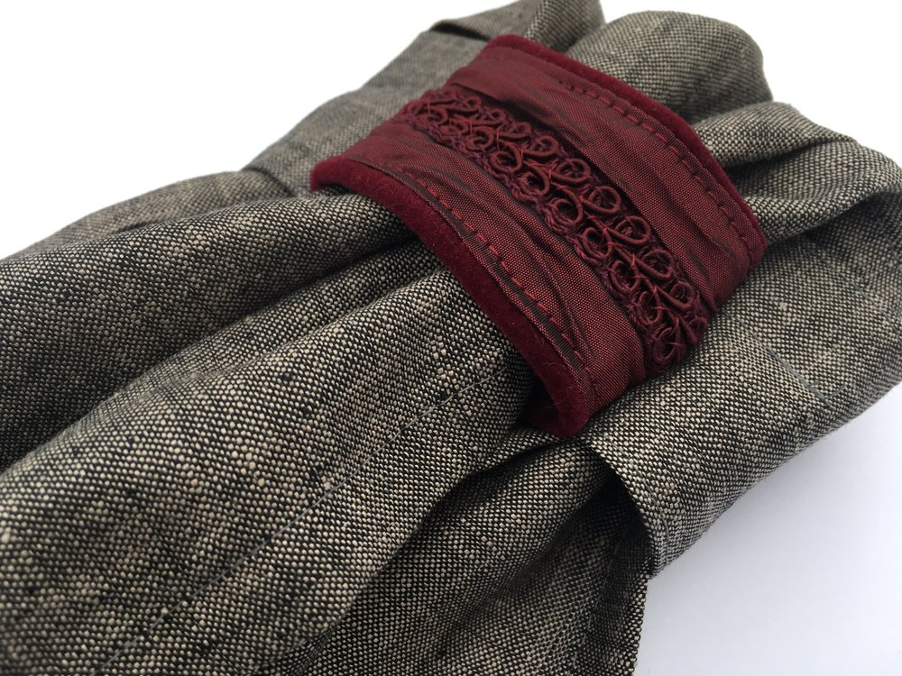 Rich red Fortuny pleated silk with textured trim overlay on gray chambray