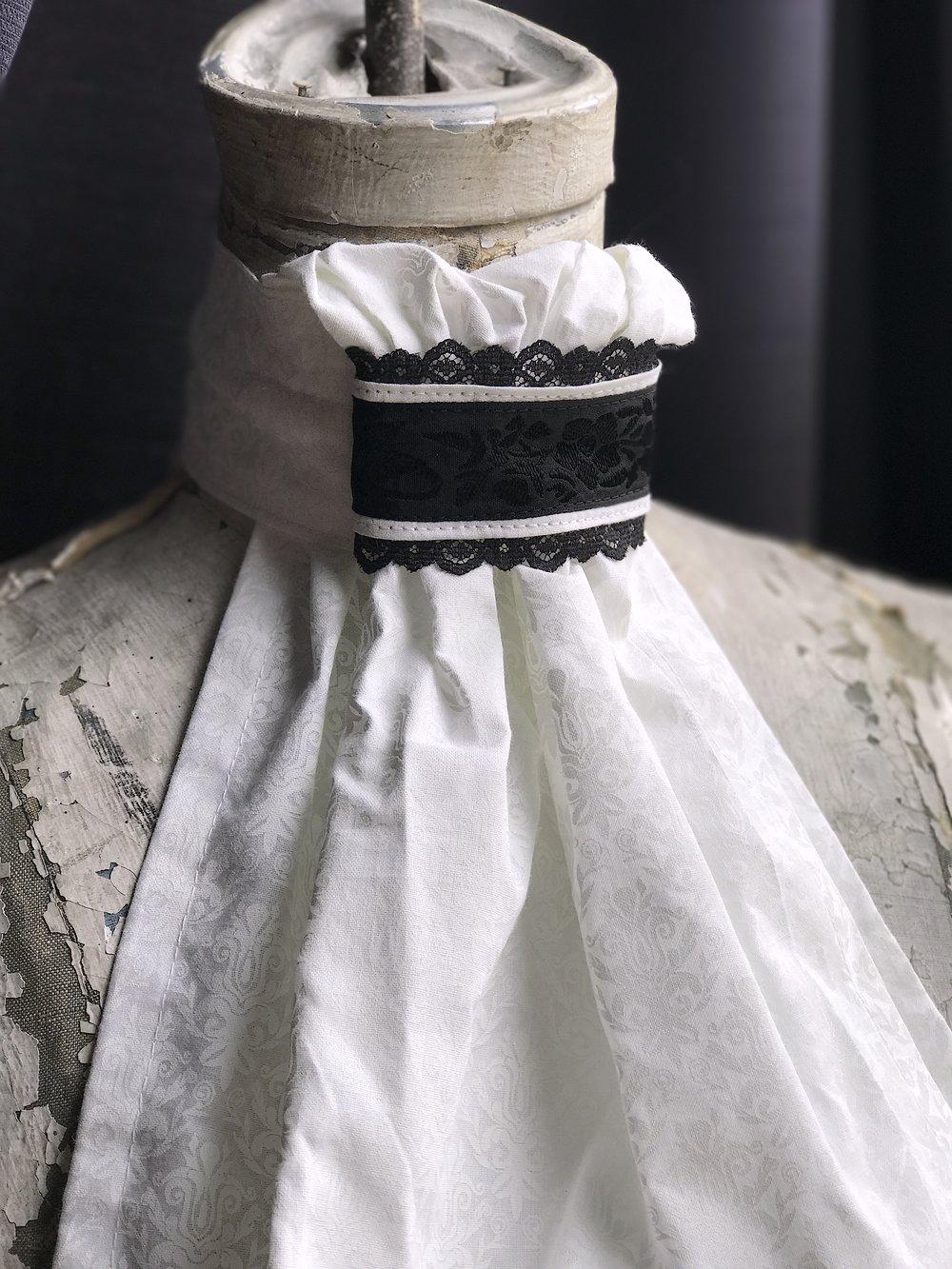 White cotton damask tone on tone tie with vintage embroidered Italian ribbon across neck