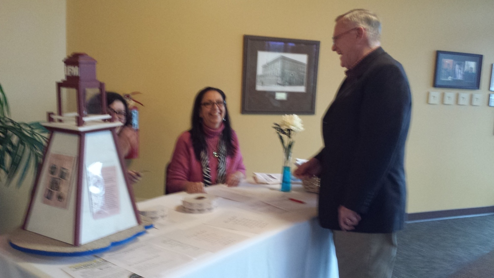 Lighthouse guests being greeted by board member: Esther Smith.  Over 120 people came to Lighthouse's Annual Celebration!
