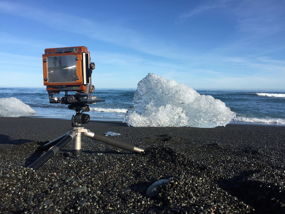 BTS of JÖKULSÁRLÓN SHORE STUDY I. My tripods go through Hell. They spend a good deal of their lives in salt water, and for this one, I dug pits for each leg to sit in, so I could get the camera as low as possible.