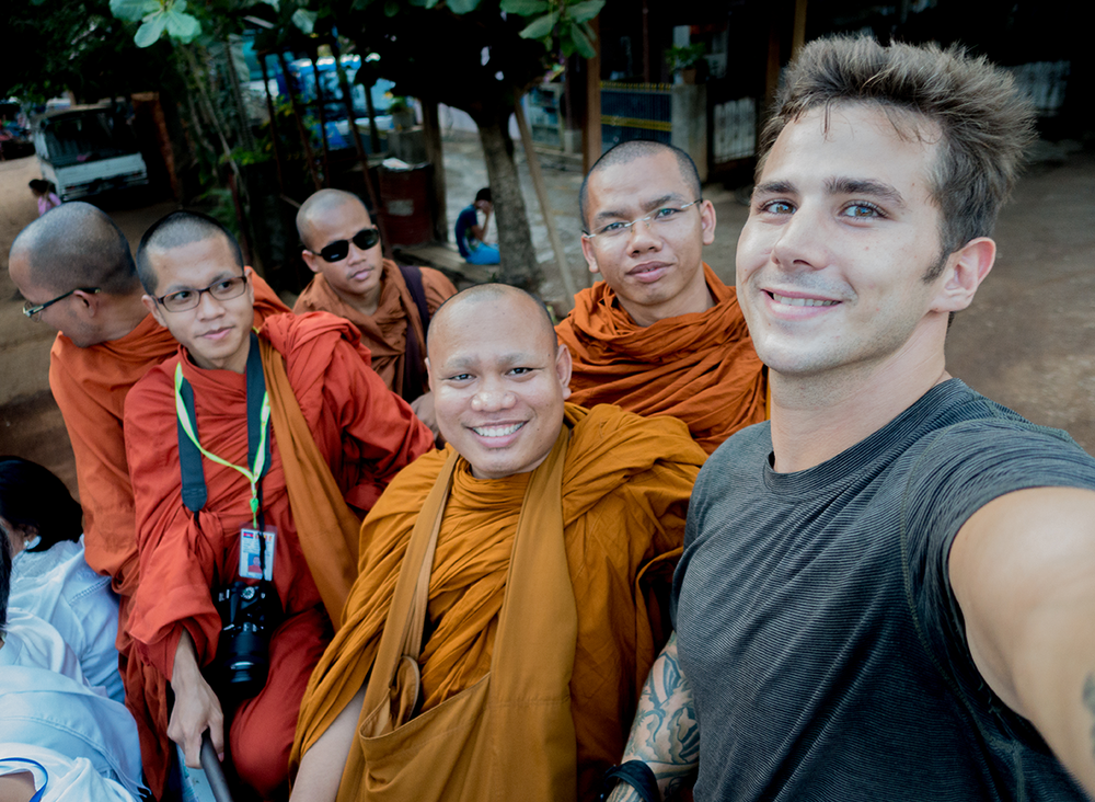 Our Cambodian monk friends. Mikey had to sit on the bench with them because women aren'tallowed to touch a monk (Mikaelawas swiftly scolded for trying to!).