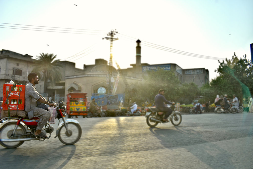 A courier speeds through the streets of Lahore, Pakistan.