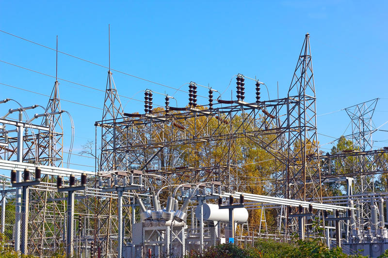 electrical-power-equipment-high-voltage-substation-industrial-landscape-fall-foliage-under-clear-blue-sky-46449958.jpg