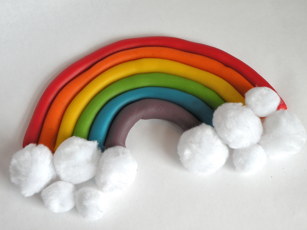 "Rolling out ZDough ""snakes"" is always a favorite activity. Arrange them to form a rainbow and add fluffy white pompoms to complete the look!"
