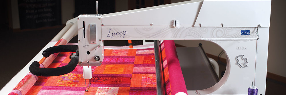 Lucey  When you quilt with Lucey, you'll quickly understand why APQS quilting machines are known for being easy to use and simple to operate.  Everything is designed, engineered and crafted to be approachable, inviting and simple to use. Lucey offers the quality and performance quilters expect from APQS at an economical price - making it an exceptional value.