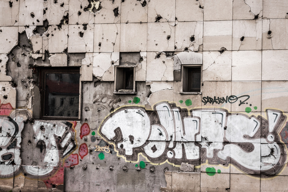 bullet riddled graffiti