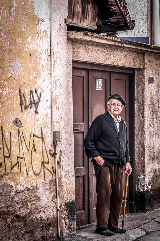 an elder man and i make eye contact in sarajevo, bosnia