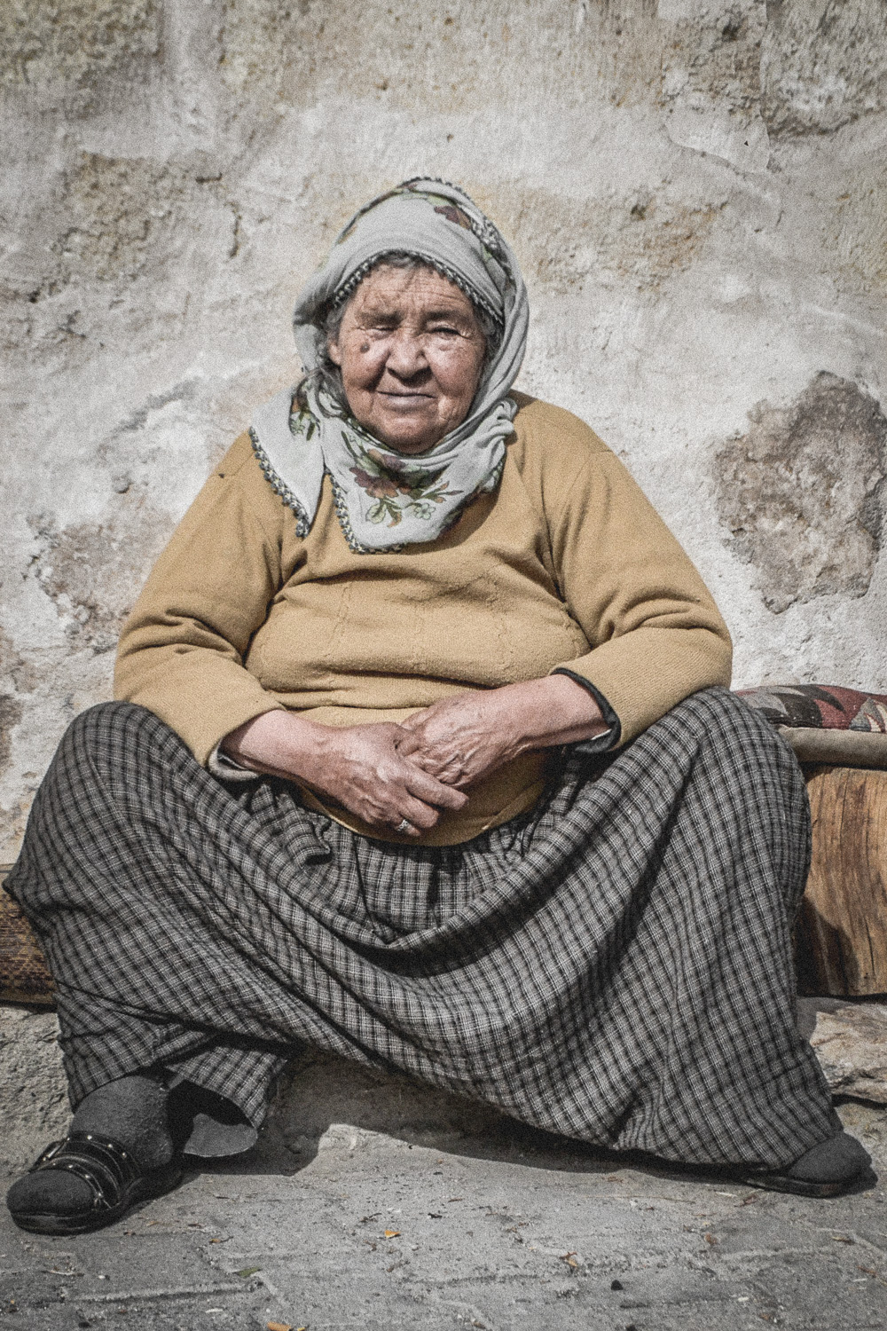 an elderly woman in goreme, turkey. she spoke no english; her daughter translated and she agreed to have her photo taken. i was told that it was one of very few images that she'd ever seen of herself