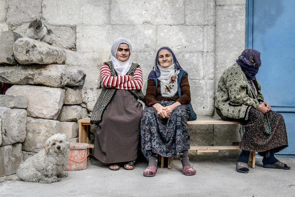 three women sit in goreme, turkey