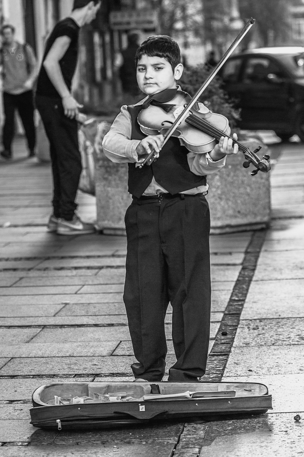 a young street musician in belgrade, serbia