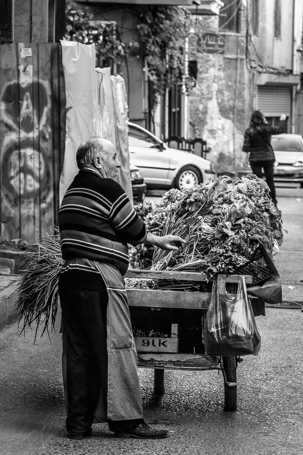 a man and his vegetable wagon in balat, the old traditional jewish quarter, located on the european side of istanbul