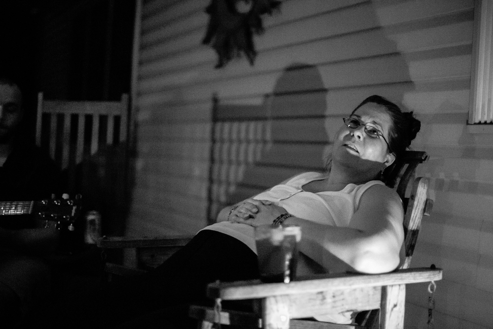 "Porch Sitting through the years and the many ups and the downs, it has always been music and what we call ""porch sitting"" that has helped to push everything else to the side and bring our family together. i was fortunate to have a childhood where the atmosphere was often one of song and campfires with my father and mother as anchors -- he playing an array of instruments and she singing.  though i no longer live at home and so much else has changed there is a a light that shines in diana's eyes and a spark in her that comes alive again when we all are together, on the front porch, the instruments are out and, even if for just a few moments, we are  ""us"" again."