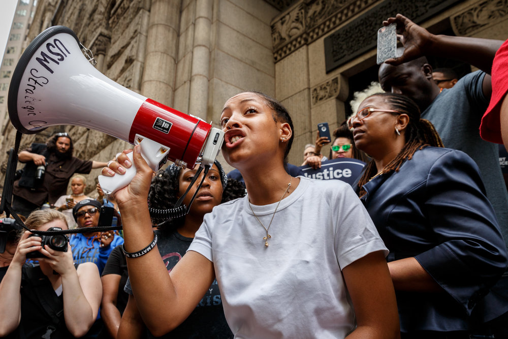Anyah Jackson, 18, of Pittsburgh, a member of the Youth Power Collective, rallies the crowd using a bullhorn.