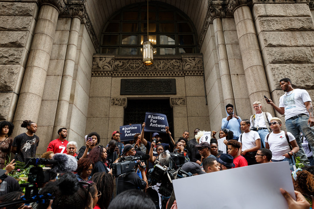 Several hundred people gathered on Grant Street in front of the Allegheny County Courthouse on Thursday to protest the death of Antwon Rose Jr. The Allegheny County police are investigating the teenager's death and named the police officer who killed him as Michael Rosfeld of the East Pittsburgh police.