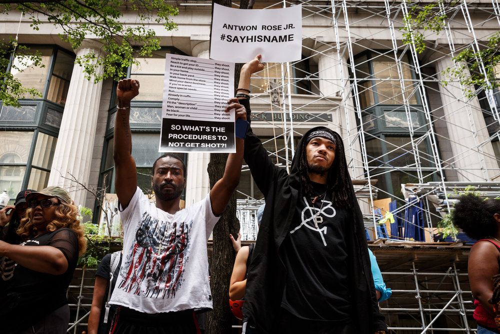 "Curtis Owens, 31, and Chon Pryor, 27, both of Pittsburgh's Northside were among several hundred protesters that attended Wednesday's afternoon demonstration. Chants of ""justice for Antwon"" rang out among the crowd."