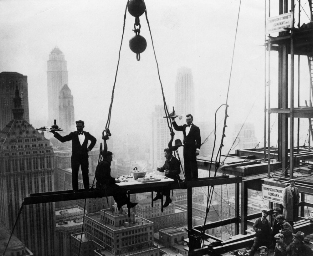 Two waiters serve two steel workers lunch on top of the Waldorf Astoria in 1930.Keystone/Getty Images