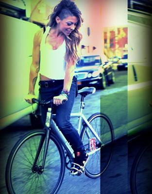 kym-perfetto-soulcycle-on-bike-