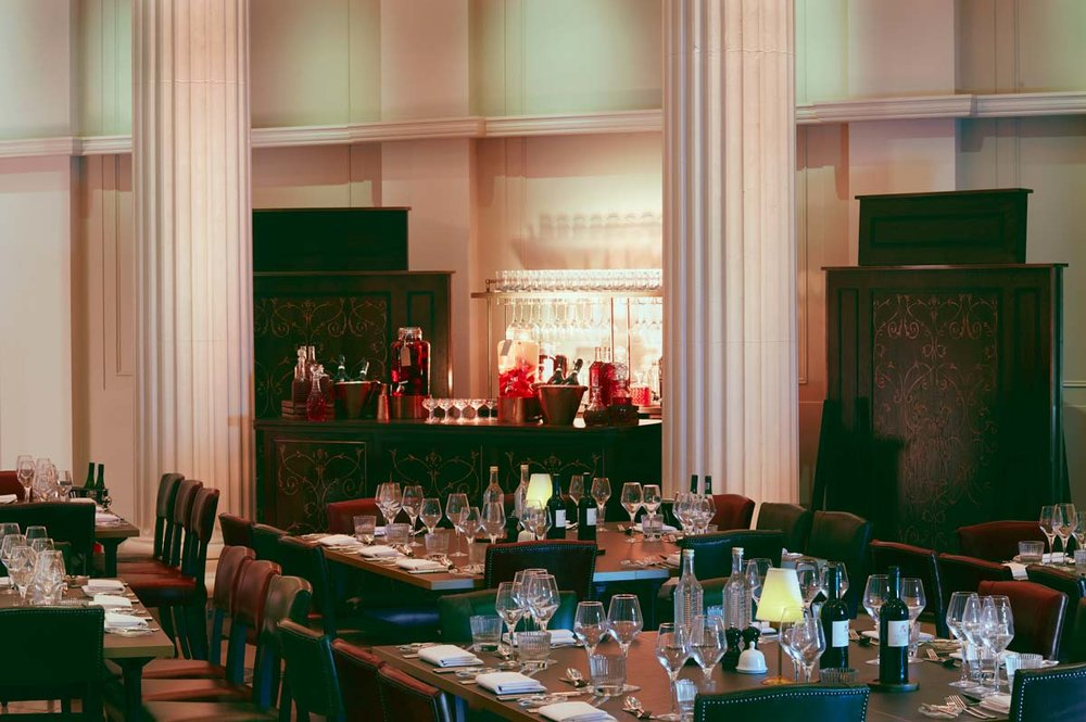 Grace Hall London venue. Wedding dinner table setting and bar.